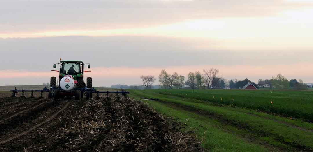 A tractor fertilizing a freshly plowed field. Photo credit Sevie Kenyon