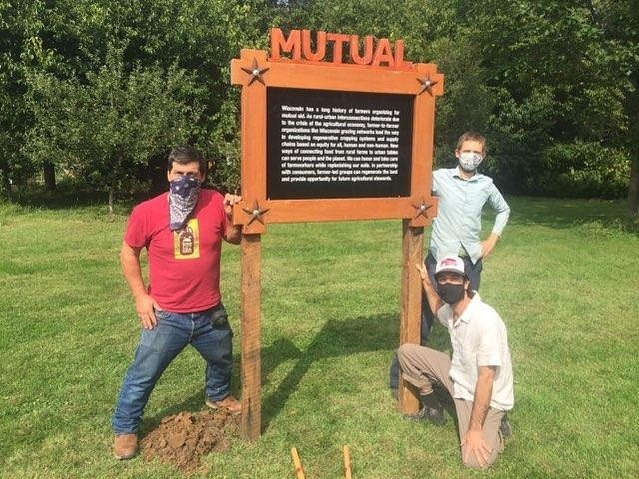 Jay Salinas of Wormfarm Institute, Kase Wheatley of Grassland 2.0, and Paul Huber of Rooted installing a field note along the DTour route.